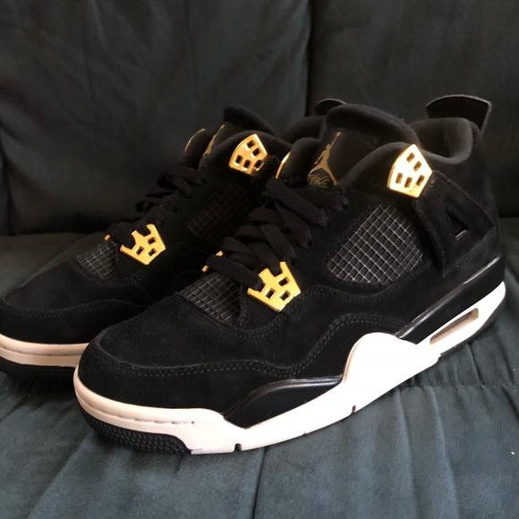 Black and gold Jordan retro 4's kids 6.5 women's 8